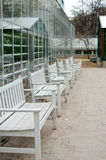 Row of white benches Royalty Free Stock Images