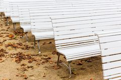 Row of white benches at an outdoor event. Picture of a row of white benches at an outdoor event Royalty Free Stock Photography