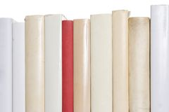 Row of white books with one red book Royalty Free Stock Images