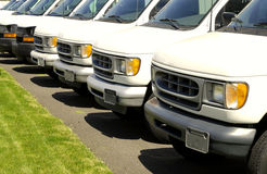 Row of white cars on a lot. With front grills Royalty Free Stock Image