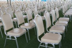 Row of white chair Stock Images