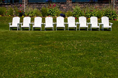 Row of white chairs Stock Photos