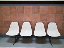 A row of white chairs Stock Photography