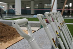 Row of white and clean shovels used for the ceremony Royalty Free Stock Images