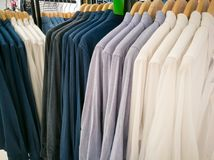 Row of white and dark shirt on the shopping mall Stock Image