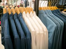 Row of white and dark shirt on the shopping mall Royalty Free Stock Photo