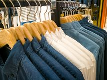 Row of white and dark shirt on the shopping mall Stock Images