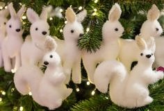 Row of white deer many figures and two proteins decoration Christmas. Row of white deer many figures and two proteins with black eyes decoration Christmas royalty free stock photos