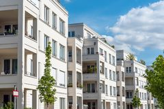 Row of white modern apartment houses seen in Berlin royalty free stock photography