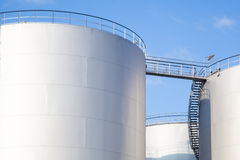 Row of white oil tanks Royalty Free Stock Images