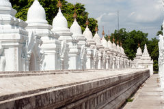 Row of white pagodas in Kuthodaw temple,Myanmar. Stock Photography