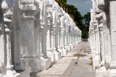 Row of white pagodas in Kuthodaw temple,Myanmar. Stock Photo