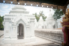 Row of white pagodas in Kuthodaw temple,Myanmar. Royalty Free Stock Images