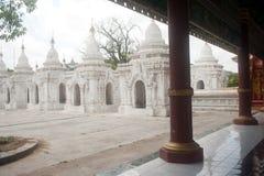 Row of white pagodas in Kuthodaw temple,Myanmar. Stock Photos