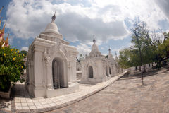 Row of white pagodas in Kuthodaw temple,Myanmar. Royalty Free Stock Photo