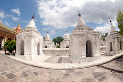 Row of white pagodas in Kuthodaw temple,Myanmar. Stock Images