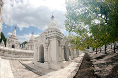 Row of white pagodas in Kuthodaw temple,Myanmar. Royalty Free Stock Image
