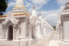 Row of white pagodas in Maha Lokamarazein Kuthodaw Pagoda in My Royalty Free Stock Photos