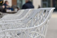 Row of white plastic chairs in close up royalty free stock image