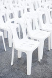 Row of white plastic chairs in outdoor event Royalty Free Stock Photos