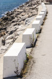 Row of white stone pylons Stock Images