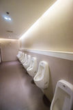 Row white urinals Stock Images