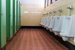 Row white urinals in men's bathroom Royalty Free Stock Image