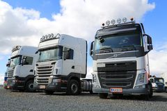 Row of White Volvo and Scania Trucks stock photography