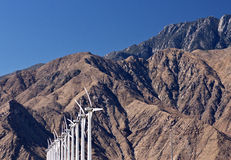 Row of White Wind Turbines At Mountains Royalty Free Stock Photo