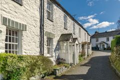 A row of whitewashed cottages in Ambleside, the English Lake Dis. A row of picturesque whitewashed cottages in Ambleside, the English Lake District Stock Image