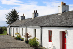 Row of whitewashed crofts in a Scottish village Royalty Free Stock Photos