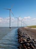 Row of wind turbines. Along the coast Stock Photos