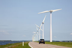 Row of wind turbines and car Stock Photo