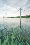 Row of wind turbines early in the morning Stock Photo