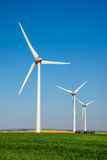 Row of wind turbines. In a field Stock Photo