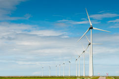 Row of windmills for generating electricity Royalty Free Stock Photos