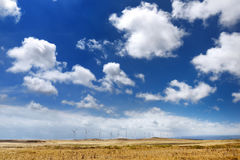 A row of windmills on the south side of the Big Island of Hawaii Royalty Free Stock Photography