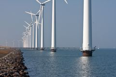 Row of windmills standing in Dutch sea Royalty Free Stock Photos