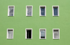 Row of windows on green wall Stock Images