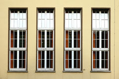 Row of windows. The photograph of four upright windows in a row stock photos