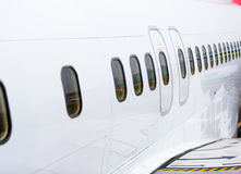 Row of the Windows in the plane. Row of the Windows on the white plane Stock Photos