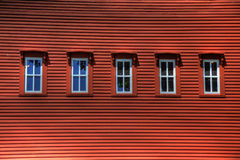 Row of Windows on Red Building. A row of windows on a red building Stock Images