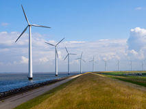 Row of windturbines. Along motorway Royalty Free Stock Photography