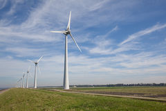 Row of windturbines at the IJsselmeer in the Netherlands Stock Images