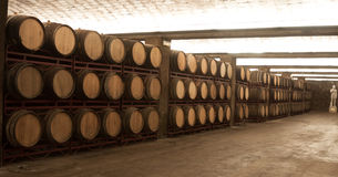 Row of Wine barrels stacked in the old winery Stock Image