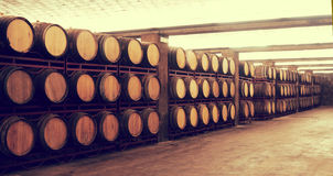 Row of Wine barrels stacked in the old winery Royalty Free Stock Image