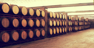 Row of Wine barrels stacked in the old winery Royalty Free Stock Photos