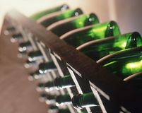 Free Row Wine Bottle In A Traditional `pupitre` Royalty Free Stock Photo - 113683255