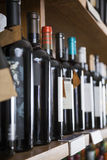 Row Of Wine Bottles Displayed On Shelf Stock Images