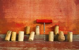 Row of wine cork and corkscrew Royalty Free Stock Photography